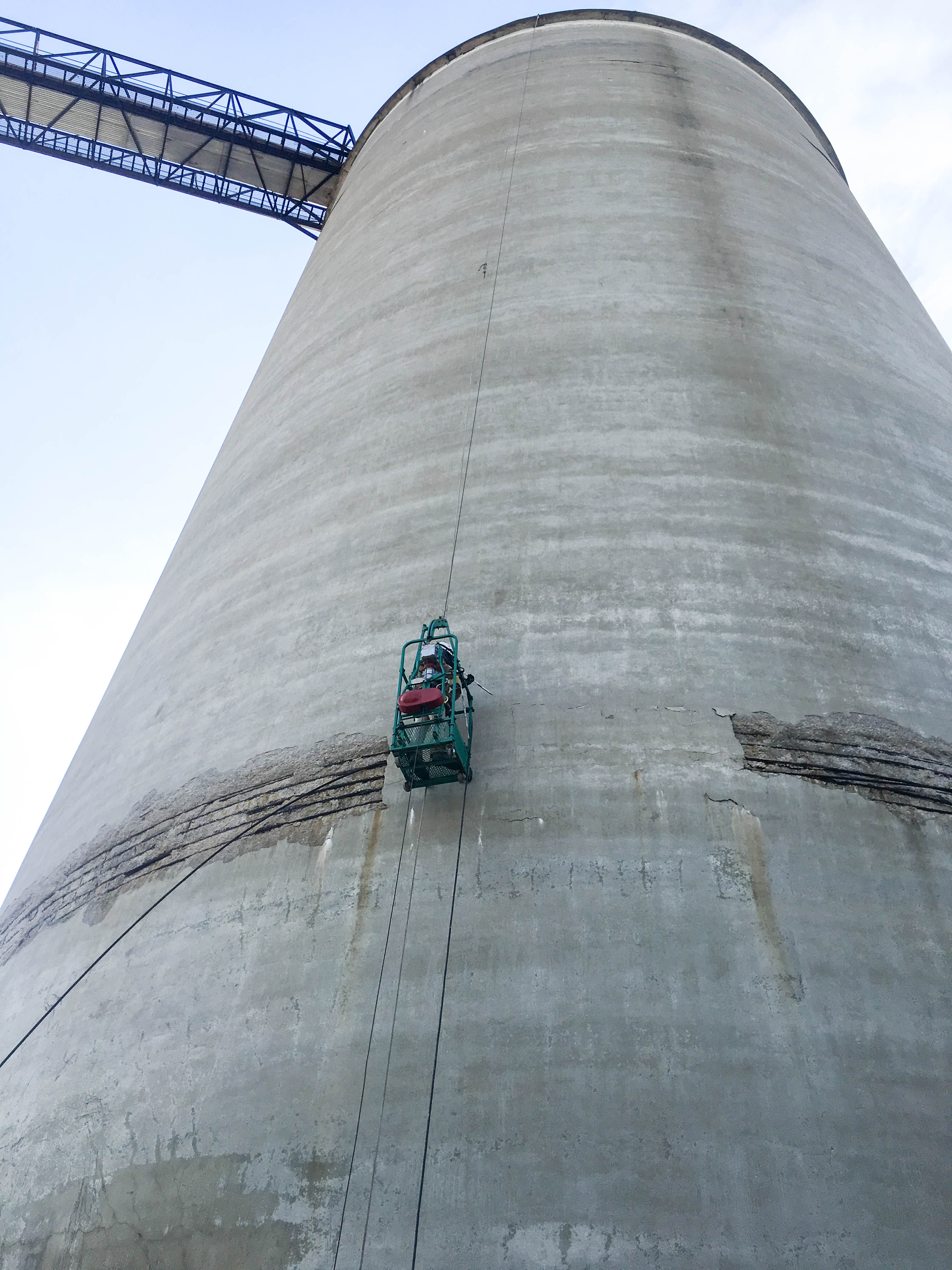 Man on side of silo performing silo inspection